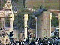 Statue of Saddam Hussein being pulled down