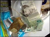 pound sterling in rubbish bin