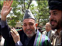 Afghan President Hamid Karzai waves to supporters during a visit to Ghazni, 29 May 2003