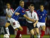 Serbia & Montenegro defender Nemanja Vidic grapples with Wayne Rooney