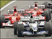 Ralf Schumacher leads brother Michael through a corner early in the race