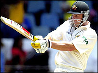 Adam Gilchrist hits another boundary during his century