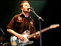 Joe Strummer playing before his death
