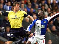 Bolton defender Gudni Bergsson tussles with Blackburn Rovers striker Andrew Cole