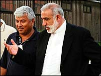 Thabet Abu Rass (left) and Father Emile Shoufani walking out of Auschwitz Camp Museum