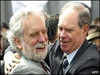 Ed Rosenthal (R) hugs his attorney Dennis Riordan as he leaves court