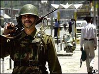 Indian soldier patrols Srinagar