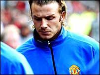 David Beckham frowns