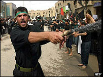 Iraqi Shia men flagellate themselves with iron chains as an act of redemption for the death of Imam Hussein