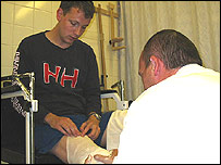 Stuart Hughes is fitted with a cast for an artificial leg