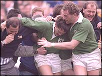 Gordon Hamilton is mobbed after scoring what seemed to be the winning try