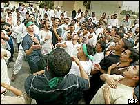 Iraqi Shia Muslims beat their chests in grief for Imam Hussein, Prophet Mohammed�s grandson, in Basra on 22 April