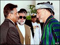 President Musharraf (left), PM Zafarullah Khan Jamali (cen), Afghan President Hamid Karzai (right)