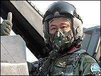 Thai Prime Minister Thaksin Shinawatra gives the thumbs up prior to his flight in an F-16B jetfighter