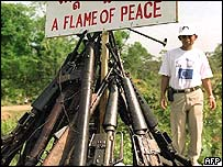 weapons of the former Khmer Rouge are piled up to be destroyed