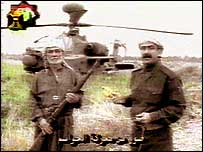 Ali Abid Minqash (left) being interviewed on Iraqi TV with the grounded apache