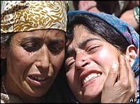 Relatives mourn victim of violence in Kashmir on 22 April