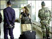 Police and soldiers at Paris Charles de Gaulle airport