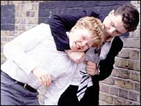 Gripper from Grange Hill attacking a fellow pupil