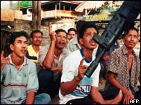 Men in Aceh are questioned by Indonesian soldiers about the Free Aceh Movement