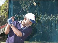 SA president Thabo Mbeki playing golf