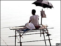 An Indian fisherman protects himself from the sun in Bhopal