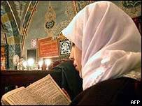 Turkish woman reads Koran in a mosque