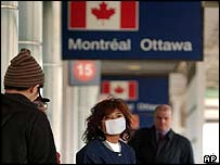 A passenger wears a face mask to protect against the Sars virus outside Pearson International Airport in Toronto