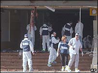 Israeli investigators at the bomb site
