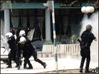 UN police run for cover during the riot in Kosovska Mitrovica