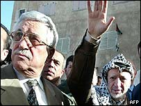 Palestinian leader Yasser Arafat (right) and newly appointed Palestinian Prime Minister Mahmoud Abbas (left)