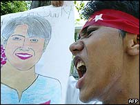 Aung San Suu Kyi supporter protests outside Burma's embassy in Thailand