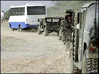 The team travels in a US military convoy on Saturday