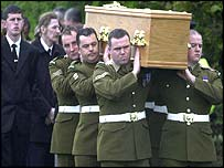 A bearer party from the Irish Guards carried the coffin