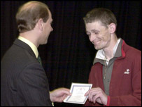 The Earl of Wessex presents an award to Jason Jennings