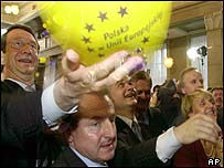 Deputy Prime Minister Marek Pol celebrates with a balloon