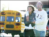 A parent escorts his daughter off the of Red Lion High School grounds