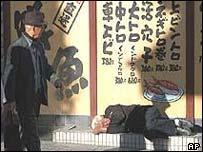 A jobless man sleeps on a Tokyo street
