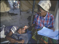 Health worker attends to a child with malaria in Africa