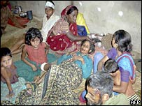 Injured villagers gather at a makeshift relief camp in Dhubri