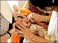 Child receiving polio vaccination, AP