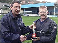 Bangor City manager Peter Davenport presents Marc Lloyd-Williams with a player of the month award