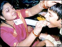 A woman administers the medicine in Hyderabad