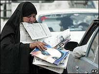 An Iraqi woman selling newspapers