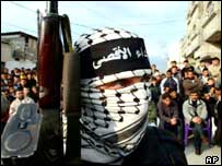 Masked gunmen from the Al Aqsa Martyrs Brigade