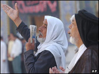 Shia Muslim men recite prayers