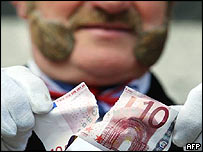 John Bull impersonator tearing up a 10 euro bank note