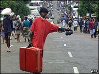 Liberians flee with whatever they can carry