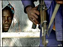 Congolese man waits to be evacuated from Bunia airport, DR Congo, 9 June 2003
