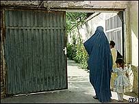 A woman waits for her son outside a Taleban vice and virtue office